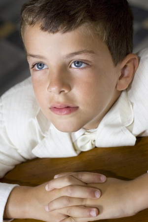 Boy praying during his first holy communion mass Stock Photo