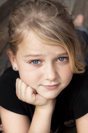 Young beautiful girl with a strong look looking at camera Stock Photo - 10527687