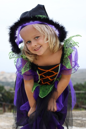 Girl dressed up for Halloween or Carnical in a witch outfit