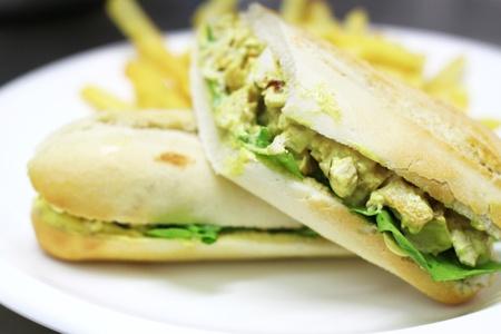Close up of chicken sandwhich, soft focus, blurred background photo