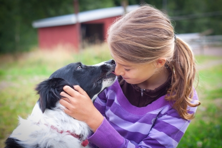Teenage child with border collie photo