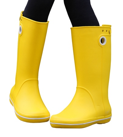 A pair of yellow rubber boots, isolated on white  With black legs photo
