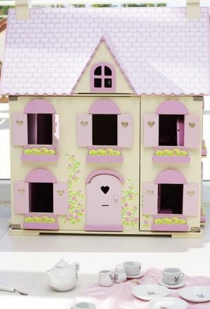 teaset: A playroom with a dollhouse and a play teaset