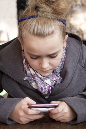 10 11 years: Child texting or playing game on smart phone