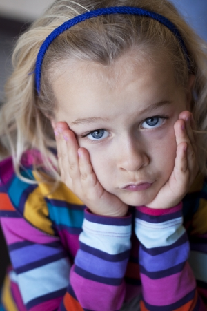 Portrait of child, grumpy and pouting Stock Photo - 17196457