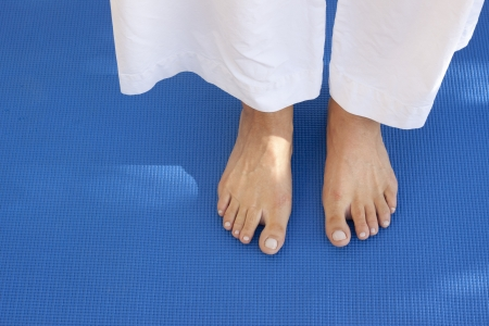 A womans feet on a training carpet  Space for text