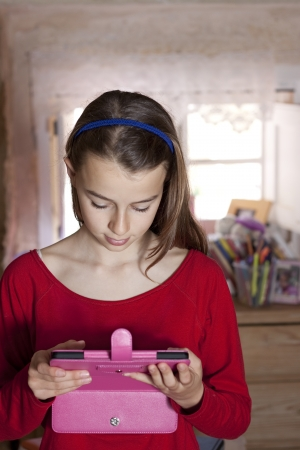 13: Girl looking at her electronic reader tablet Stock Photo