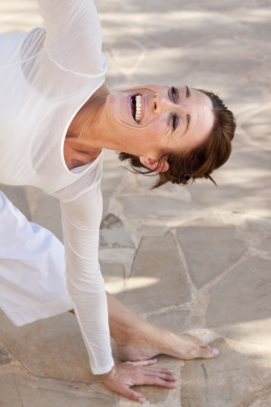 A flexibel middle age senior woman doing yoga photo