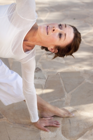 yoga meditation: Happy woman doing advanced yoga
