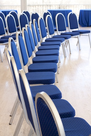 presentaion: Curved row of empty conference chairs Stock Photo