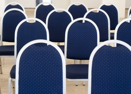 presentaion: close up of blue empty conference chairs