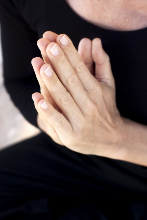 Hands held together in prayer or yoga greeting Stock Photo