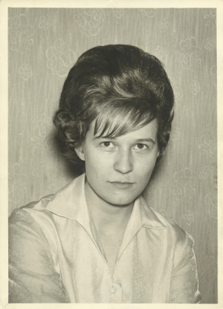 20 year old: old scratched  black and white portrait old photograph of a woman from the 60s Stock Photo