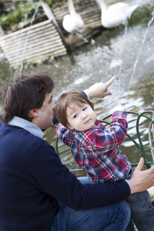 paternity: A father with his son at the park  Candid shot, real people Stock Photo