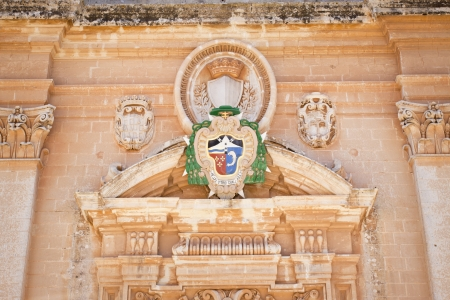 plaza of arms: A coat of arms on the facade of the Mdina Cathedral in Malta. Plaza San Paul St. Pauls Cathedral Stock Photo