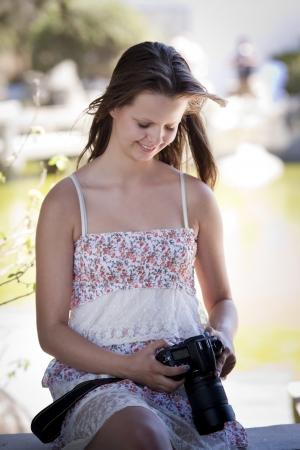 taken: A teenager looking at photos taken with her digital DSLR camera Stock Photo
