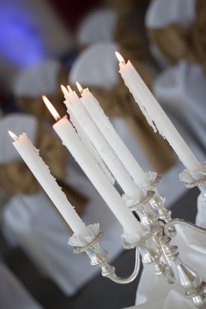 candelabra: Close up of a silver candelabra with lit candles, shot in a tilted angle