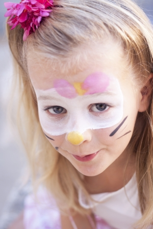 hairclip: A girl with face painted for a party or carnival Stock Photo