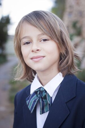 private school: Girl in school blazer and tie, looking at camera Stock Photo