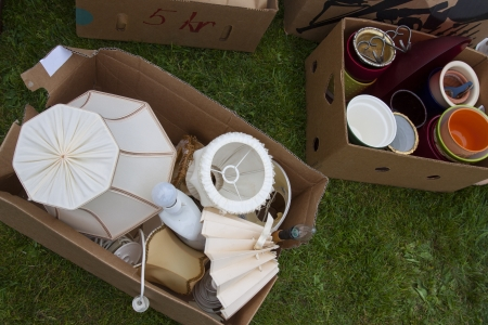 Boxes with lamps and other junk put out for an auction photo