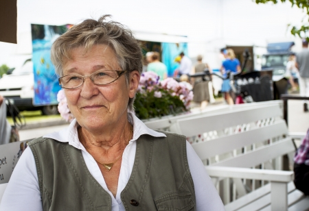 Happy retired pensioner woman sitting alone in an outdoor cafe Stock Photo - 21471526