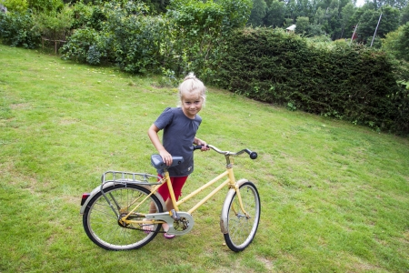 eight year old: A small girl learning to ride a bike  positive feeling Stock Photo