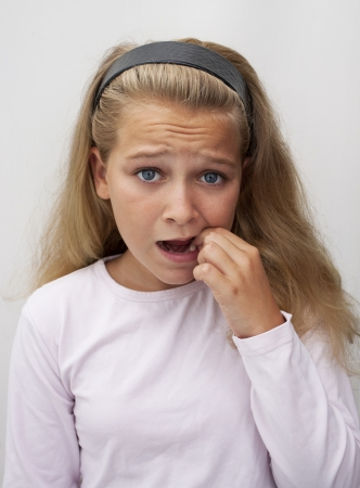uneasiness: Teenage girl wtih tooth ache