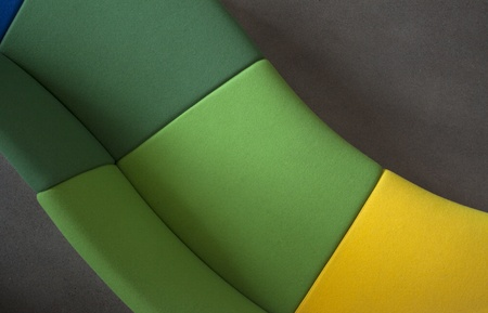Detail of a curved sofa in green and yellow,  shot from above Stock Photo - 21654785