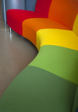 furniture detail: A curved modern sofa in different colors