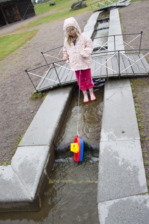 real people: A young girl playing at Gota Canal, Sweden, Scandinavia, Europe