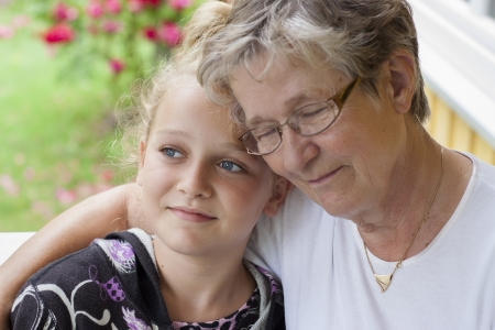 And old woman with eyes closed hugging a young child Stock Photo - 21845806