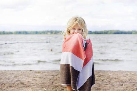 6 7 years: A 7 year old child wrapped up in a towel after a swim Stock Photo