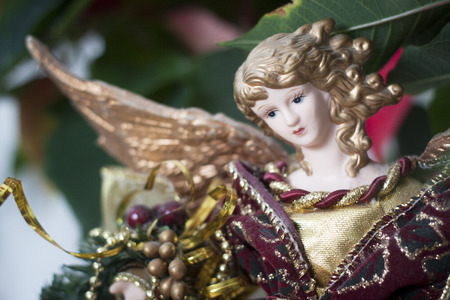 kitsch: Close up of a porcelain Christmas angel blurred background