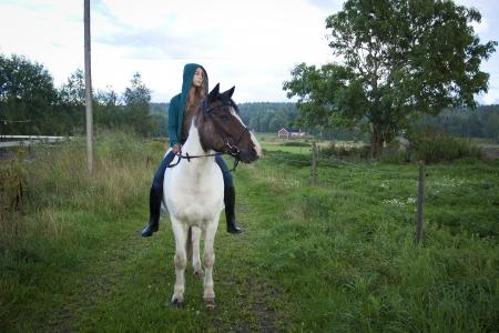 girl on horse: A teenager riding an icelandic horse bareback Stock Photo