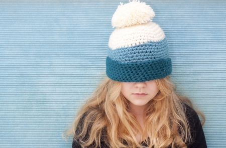 pulled over: Teenager with hat pulled over her eyes. Space for text Stock Photo