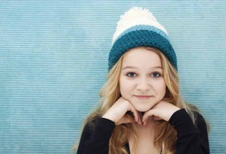 woolly: Girl with long blond hair and woolly cap space for text