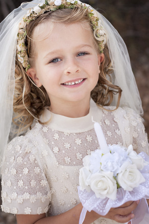 jesus christ communion: A young child doing her first holy communion Stock Photo