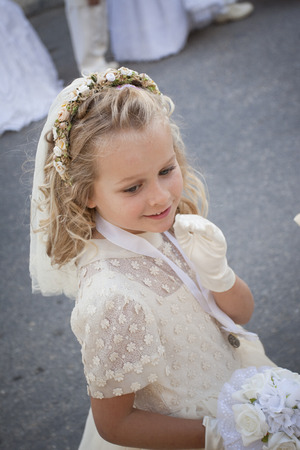 procession: A young child doing her first holy communion Stock Photo
