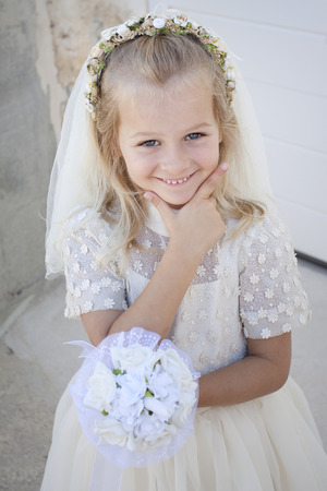 A young child doing her first holy communion Stock Photo
