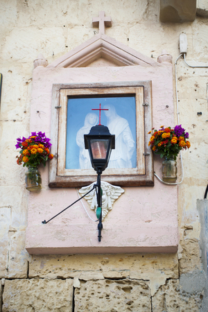 holy mary: flowers and lights around a religious christian picture of jesus and Holy Mary in Valletta, Malta, Europe