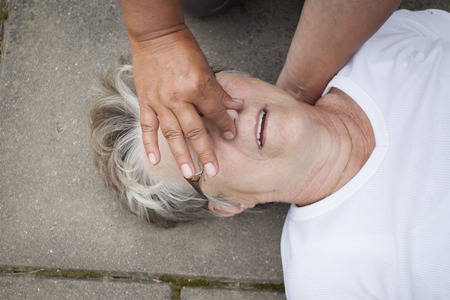 passerby: A sick senior old lady receiving mouth to mouth resuscitation, kiss of life