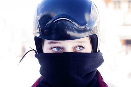 neck scarf: Close up of child wearing a helmet for skiing or snowboarding. Differentiated focus