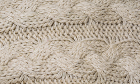 acrylic yarn: Fragment of knitting patterns. Artificial wool. Close-up.