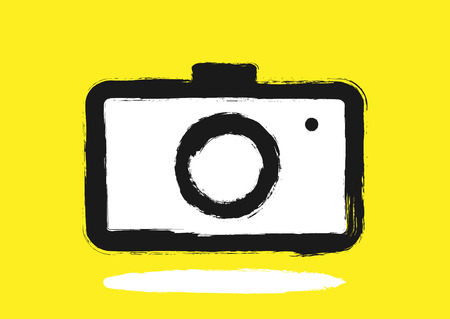 Logo camera painted by hand with a rough brush. Grunge, sketch, graffiti, ink. Black, white, yellow. Vector illustration.