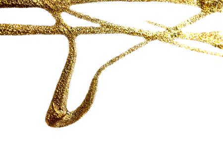 Flows of golden nail polish with glitter on white background. Rectangular horizontal photo.