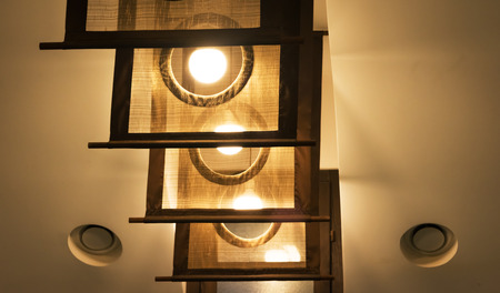 Group of stylish fabric lamps on ceiling. Creative idea for home design. Фото со стока