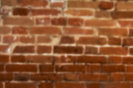 Blurred texture of old brick wall. Rectangular horizontal background with blur.