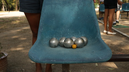 Vintage Petanque Balls on Old Blue Chair