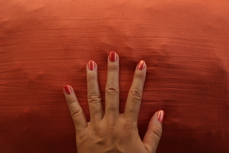 Retro Manicured Hand Painted Orange on Matching Background Imagens