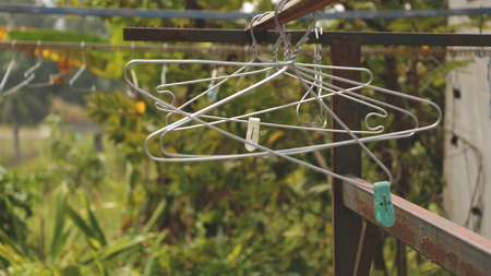 Vintage Clothes Hangers on Rusty Rack in the Garden - Countryside Vietnam Stock Photo
